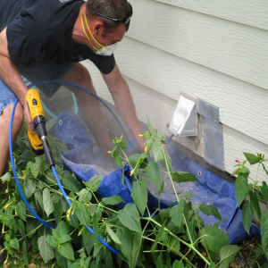man cleaning a dryer vent